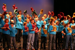 chorus with blue shirts and hats