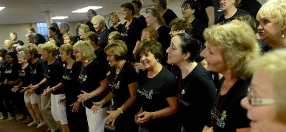 Photo of chorus at rehearsal. Pittsburgh Post Gazette.